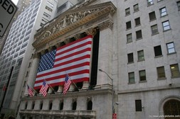 New York Stock Exchange Building with huge American Flag at Wall Street NY.jpg