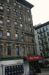 Old apartment building some without windows in New York.jpg