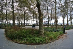 Trees and walkways near ocean at Battery Park Manhattan NYC.jpg