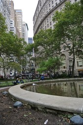 View of circular building & high-rises from Bowling Green Park Manhattan New York.jpg