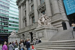 Roman statues on side of entrance to US Custom House National Museum of American Indian Manhattan New York.jpg