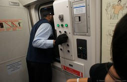 PATH Train conductor for train from World Trade Center to New Jersey.jpg