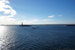 Statue of Liberty in the distance as cruise ship approaches.jpg
