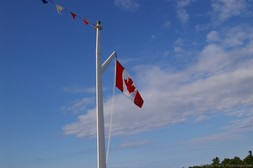 Gananoque Boat flying Canada Flag.jpg