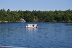 RV-like boat on the waters of St Lawrence River 1000 Islands.jpg