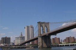 Brooklyn Bridge and the Verizon Building seen from the East River.jpg