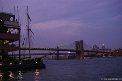 Brooklyn Bridge at night as seen from Pier 17 South Street Seaport in Manhattan.jpg