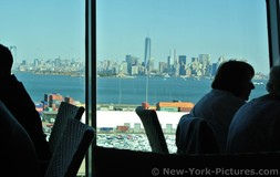 View of Manhattan New York City One World Trade Center from Windjammer Cafe Royal Caribbean Explorer of the Seas docked at Cape
