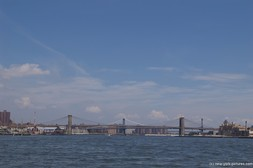 Brooklyn Bridge as seen from the harbor in Manhattan New York.jpg