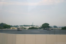 View of Statue of Liberty in the distance from tour bus.jpg