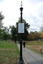 Lamp post at Boston Common Park showing 11 PM closing time.jpg